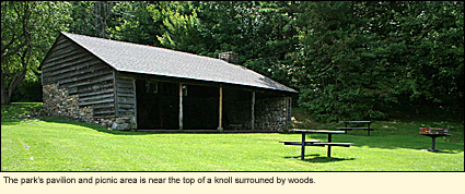 The Harriet Hollister Spencer Memorial Recreation Area's pavilion and picnic area is near the top of a knoll surrounded by woods.